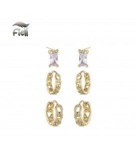 set van drie sierlijke goudkleurige oorbellen