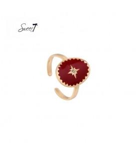 goudkleurige ring met rode steen met ster
