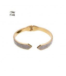 goudkleurige spang armband met punten aan de uiteinden en kleine steentjes
