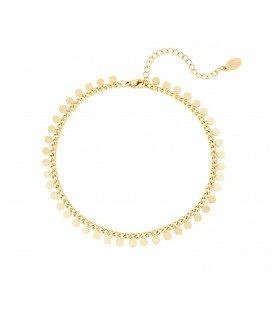 goudkleurig enkelbandje met cirkeltjes
